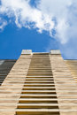 High-rise building modern architecture. Looking up blue sky white clouds, daylight urban landscape background, bottom Royalty Free Stock Photo