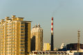High rise building and smokestack with iron tower in harbin heilongjiang province china Stock Photo