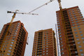 High rise construction brick houses under Stock Photography