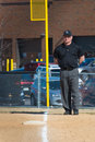 High school baseball umpire mans first base and the right field foul line Royalty Free Stock Photo