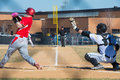 High school baseball umpire watches the batter and catcher Royalty Free Stock Photo