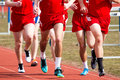 High School Boys Racing the Mile Royalty Free Stock Photo