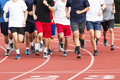 Group of high school boys running on a track Royalty Free Stock Photo