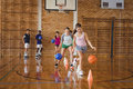 High school kids practicing football using cones for dribbling drill