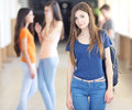 High school student at in the hallway classmates in the background Royalty Free Stock Image