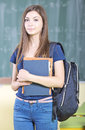 High school student at in the hallway classmates in the background Royalty Free Stock Images