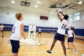 High school volleyball match in gymnasium horizontal image of having fun Stock Photos