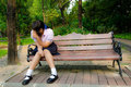 High-Schoolgirl crying alone on the bench Royalty Free Stock Images