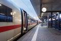 High speed passenger train on railroad platform. Railway station Royalty Free Stock Photo