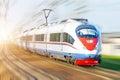 High-speed passenger train rushing through rail in Europe. Royalty Free Stock Photo