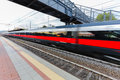 High speed passenger trains on railroad platform in motion. Blur effect of commuter train. Railway station in Florence, Italy. Royalty Free Stock Photo