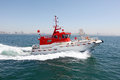 A high speed pilot boats leading the ship into the territory of the Stock Photos