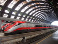 High speed train awaits departure at Milan StationThree logging steam locomotives on parade Royalty Free Stock Photo