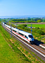 High speed train in open area with full landscape Royalty Free Stock Photos