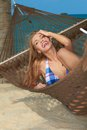 High-spirited laughing woman in hammock Royalty Free Stock Photo