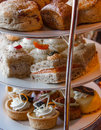 High tea sandwiches and goodies at Stock Photography