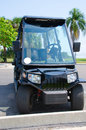High tech expensive golf cart with headlights full windshield and rear view mirrors Royalty Free Stock Photos