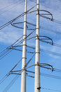 High tension pylons with powerlines in the netherlands Royalty Free Stock Photo