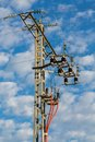 High tension tower detailed view of over cloudy sky Stock Image
