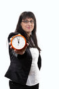 It is high time business lady lifts up a alarm clock with sohwing there no more to waste Stock Images