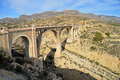 A high viaduct railway bridge in the mountains Royalty Free Stock Images