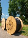 High voltage black electrical cable rolled on large cable reels