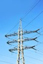High voltage electric line lines pylon on blue sky background Royalty Free Stock Images