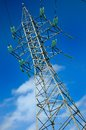High voltage electric pole on a blue sky background Stock Photography