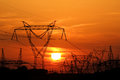 High voltage electric pole during sunset Royalty Free Stock Photos
