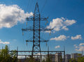 High voltage electric transmission line and pylon against cityli Royalty Free Stock Photo