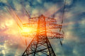High voltage electric transmission tower at sunset. Royalty Free Stock Photo