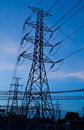 High voltage electricity pillars and blue sky Royalty Free Stock Photo