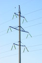 High voltage electricity pillars  on the blue  sky background Royalty Free Stock Photo