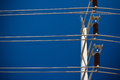 High voltage electricity pole in blue sky Stock Photo