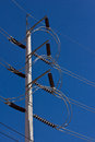 High voltage electricity pole in blue sky Royalty Free Stock Images