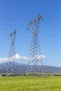 High voltage electricity pylons in rural landscape Royalty Free Stock Photography