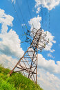High voltage line and cloudy sky beneath the blue Stock Images