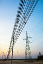 High voltage pole post tower at sky background Royalty Free Stock Photo