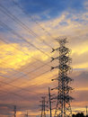 High voltage poles silhouette with beautiful sky in sunset Stock Images