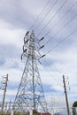 High voltage post high voltage tower cloudy sky background Stock Photos