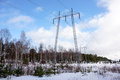 High voltage post or high voltage tower electricity transmission pylon with cloudy sky in winter finland Stock Photos