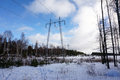 High voltage post or high voltage tower electricity transmission pylon with cloudy sky in winter finland Stock Image
