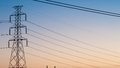 High voltage post high voltage tower sky background in evening twilight Royalty Free Stock Photos