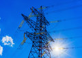 High voltage post high voltage tower sky background sun Royalty Free Stock Photography