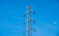 High voltage post or power transmission line tower and blue sky Royalty Free Stock Photo