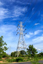 High voltage post tower on blue sky Stock Photos