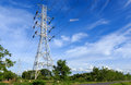 High voltage post tower on blue sky Stock Images