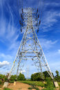 High voltage post tower on blue sky Royalty Free Stock Images