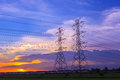 High voltage post tower and power line on sunset sky background Royalty Free Stock Photo