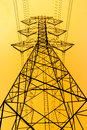 High voltage post on yellow background the Royalty Free Stock Photo